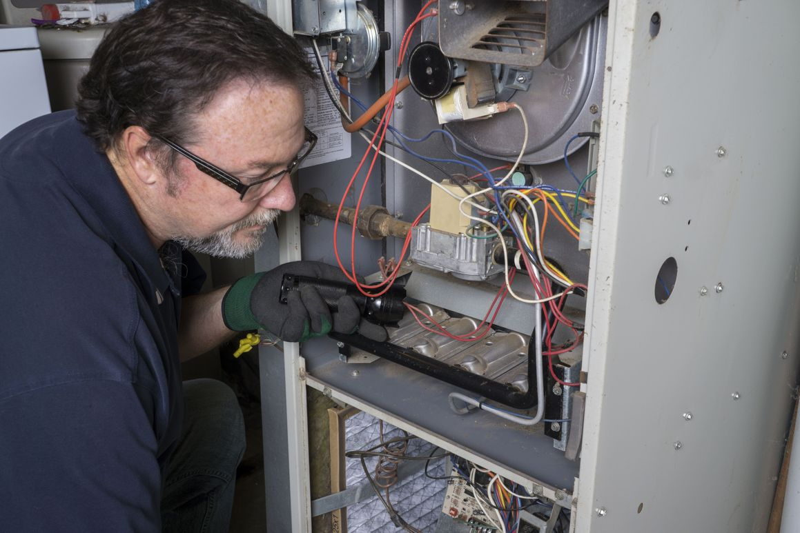 furnace being serviced